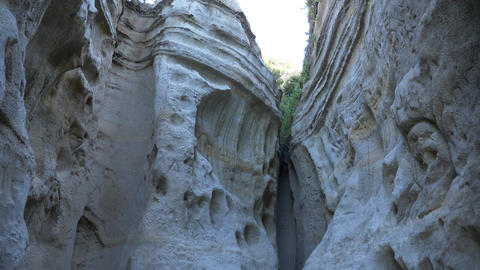 Walking thru canyon close up Scenic Landscape Marine bluffs on the beach, San Live Action