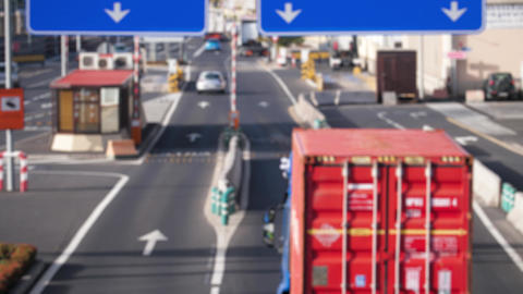 4k out of focus blurrred video of delivery cargo trucks riding on big busy Live Action