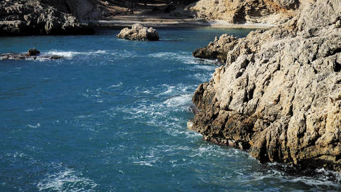 Crashing waves on rocksin Calo den Monjo, landscape nature view and Beautiful tropical sea with Sea Live Action