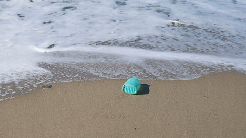 Plastic soap container flow in sea waves shore,dirty ecosystem, industrial trash Live Action