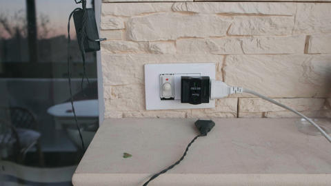 camera come close to an electric plug and multi outlets faster at home with Live Action