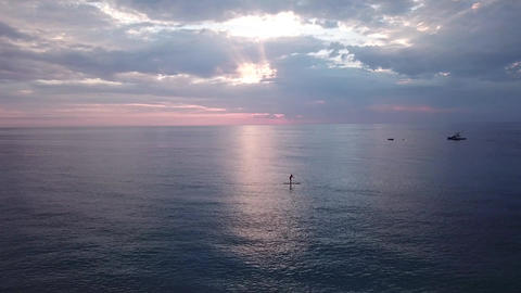 Calm sea with paddleboarder Live Action