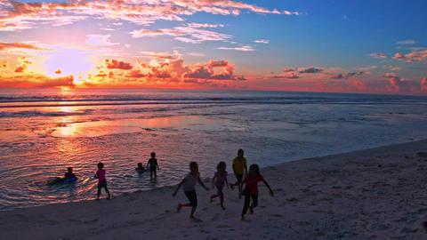 Kids having fun on the beach Live Action