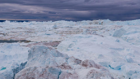 Icebergs from melting glacier in icefjord - Global Warming and Climate Change Live Action