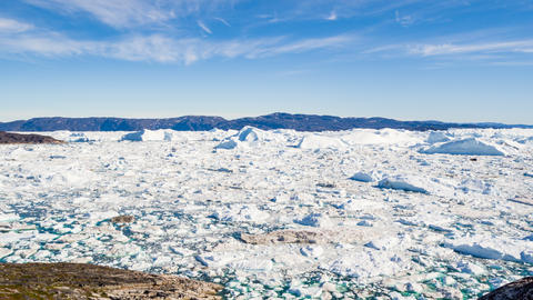 Arctic nature landscape with icebergs in Greenland icefjord - aerial drone video Live Action