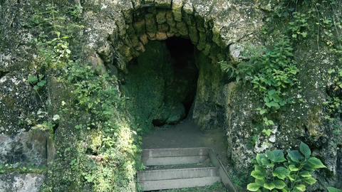 Entrance to the small and old Cave in Europe Live Action
