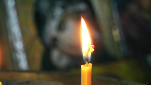 Candle is burning and the icon of the goddess with jesus GIF
