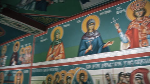 Icons of saints on the wall and the Prayer Altar in the Orthodox Church GIF