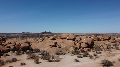 Huge round rocks and mountains on the horizon of a desert, Erongo, Namibia Live Action