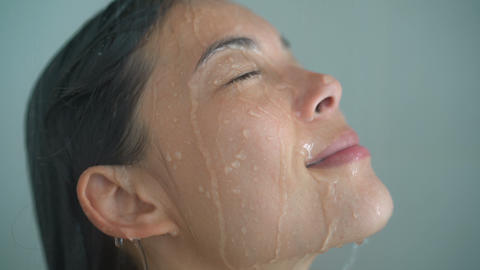 Shower woman showering relaxing washing face under running water Live Action