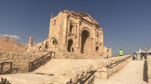 Jerash, Jordan - October 15, 2019: tourists walk on stone roads part 6 Live Action