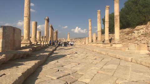 Jerash, Jordan - October 15, 2019: tourists walk on stone roads part 3 Live Action