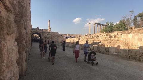 Jerash, Jordan - October 15, 2019: tourists walk through the ruins of the old Live Action