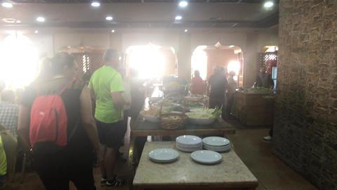 Jerash, Jordan - October 15, 2019: tourists in the restaurant Live Action