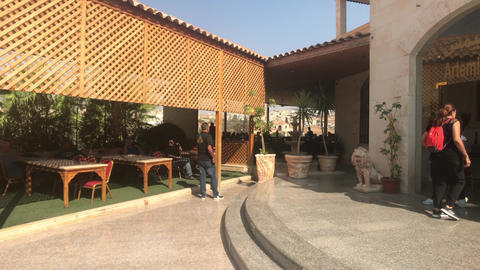 Jerash, Jordan - October 15, 2019: tourists in the restaurant part 2 Live Action