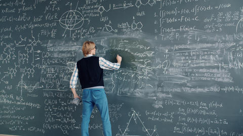 Time lapse of creative guy researcher writing formulas on chalkboard in class Live Action
