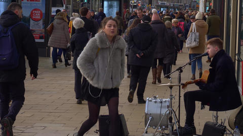 Street musician at Princes Street Edinburgh - EDINBURGH, SCOTLAND - JANUARY 10 Live Action