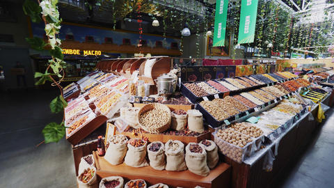showcase of tasty dried fruits and digital scale at market Live Action