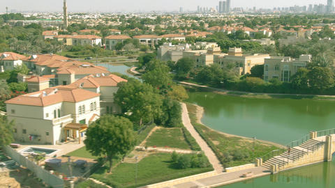 Low altitude aerial view of Jumeirah Islands community waterfront villas. Dubai Live Action