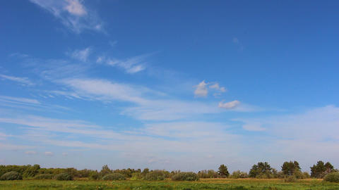 Beautiful blue sky over the meadow Footage