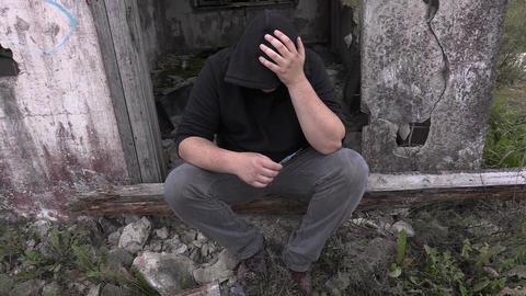 Drug addict man with syringe near abandoned building Footage