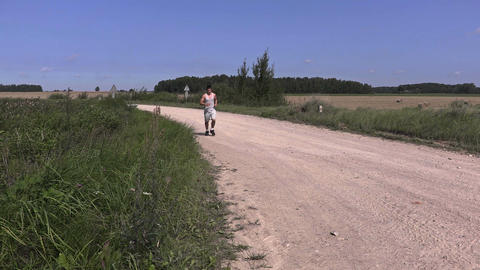 Young runner on rural road Footage