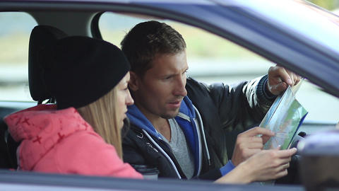 Cute couple in car looking for the right direction Footage