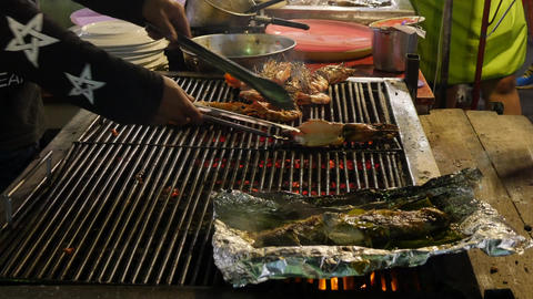 The cook makes grill fish and shrimp. Cooking mackerel fillet at grill for fish Footage