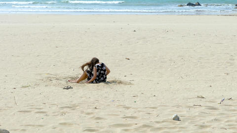 Girl playing in sand anon Live Action