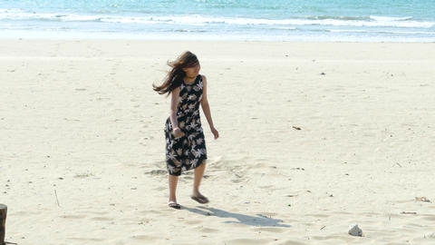 Girl walks on beach to camera Live Action