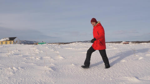 A young man walks along the coast of the Pacific ocean in winter 002 Live Action