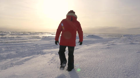 A young man walks along the coast of the Pacific ocean in winter 001 Live Action