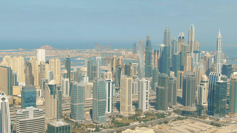 Aerial shot of the Dubai Marina skyscrapers and the Palm Jumeirah Islands, UAE GIF