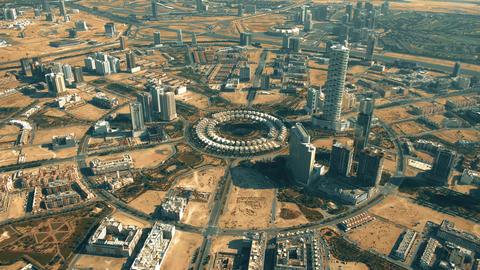 Aerial shot of Jumeirah Village Circle, a community in Dubai, UAE Live Action