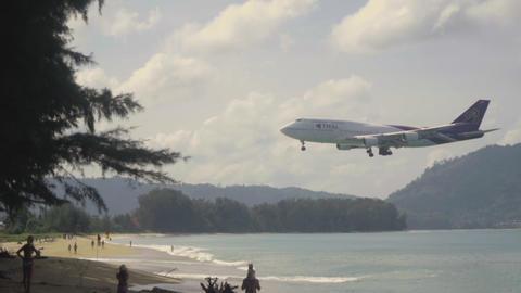 Thai Airways Boeing 747 approaching over ocean GIF