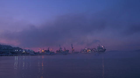 Time lapse ships at sunrise standing in the port Live Action