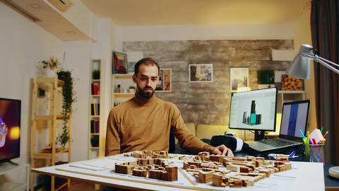 Young architect using augmented reality holograms GIF