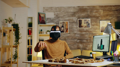 Young architect using virtual reality goggles GIF