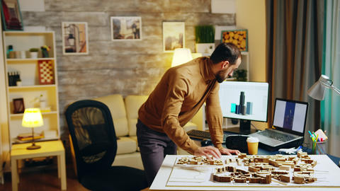 Architect working at night in his home office GIF