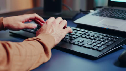 Close up of engineer hands typing on keyboard GIF