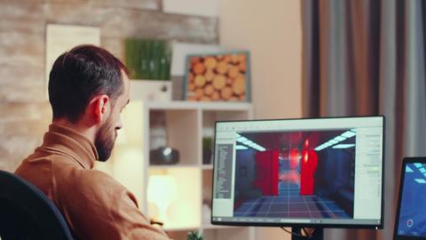 Game creator testing the graphics using modern computer GIF