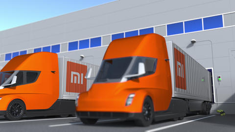 Electric trailer trucks with Xiaomi logo being loaded or unloaded at warehouse GIF