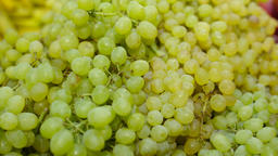 Fresh Raw Green grapes in a counter of market GIF