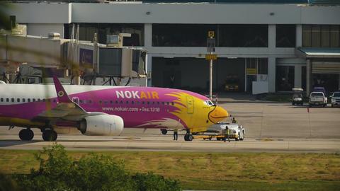 NOK Air Boeing 737 pushing back GIF