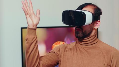 Engineer wearing virtual reality headset GIF