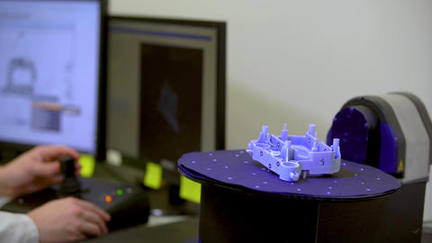 Professional technician scans 3d model using laser with blue beam Live Action