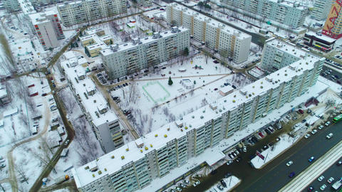comfortable apartment complex with snowy yard aerial view Live Action