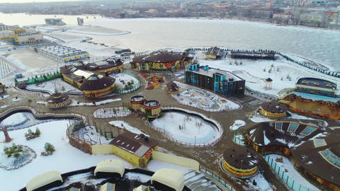 beautiful modern amusement park on cold winter day aerial Live Action