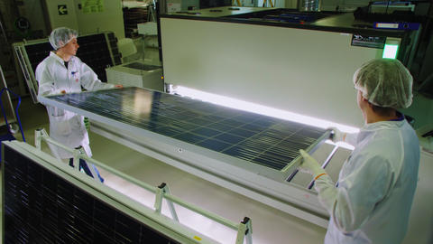 employees put solar panel into box with led lamps in shop Live Action