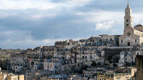 High view of architecture skyline of matera,italy,church,clouds motion timelapse Acción en vivo
